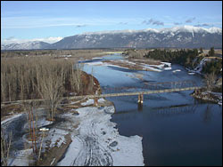 Old Steel bridge on blue bird day (heli shot) Kalispell, MT Winter Aerial