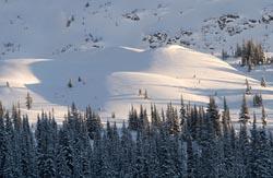 Sunrise lights the hills Golden, Canada Winter Landscape