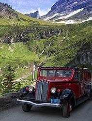 Jammer Bus on Going to the Sun Highway Glacier Park Summer Landscape