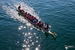 Dragon Boats with sun flare BigFork, MT Summer Aerial