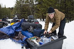 Packing the sleds Nikko Cabin, MT Winter Snowmobiling