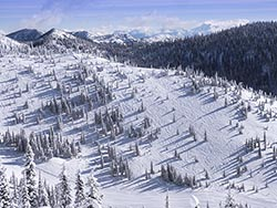 One guy skiing East Rimm Big Mountain Winter Aerial