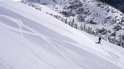Lone skier on Inspo Big Mountain Winter Aerial