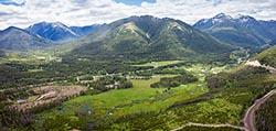 Property boarding Glacier National Park Essex, MT Summer Aerial