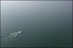 Lone boat on Whitefish Lake Whitefish Lake, MT Spring Aerial
