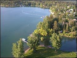 Whitefish River running into the lake Whitefish Lake, MT Spring Aerial